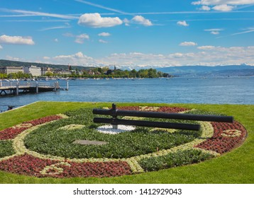 Zurich, Switzerland - May 31, 2019: Lake Zurich, summits of the Alps in the background, view from the city. Lake Zurich is a lake in Switzerland, extending southeast of the city of Zurich.