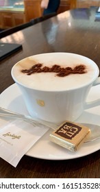ZURICH / SWITZERLAND - NOVEMBER 13 2018: detail of a cappuccino with sprungli written on it with cacao in sprungli shop in zurich