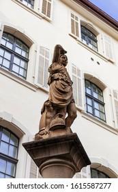 Zurich, Switzerland / November 2019: Woman Statue with helmet in fresh water public fountain