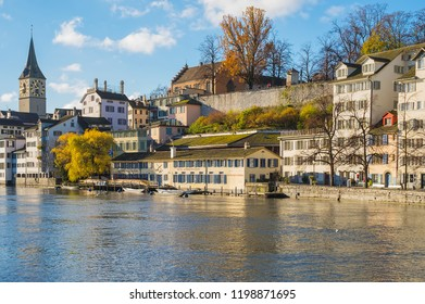 Zurich, Switzerland - November 25, 2013: the Limmat river and buildings of the historic part of the city of Zurich along it. Zurich is the largest city in Switzerland.