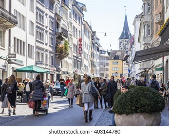 ZURICH, SWITZERLAND, on MARCH 26, 2016. Typical urban view in the spring morning. People go on a shopping street