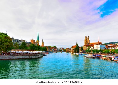 Zurich, Switzerland - September 2, 2016: Limmat River Quay with boats and three main churches of Zurich - Grossmunster, Fraumunster and St Peter Church, in Switzerland