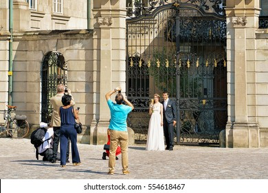 Zurich, Switzerland - September 2, 2016: Just married couple being photographed in the streets in the city center of Zurich, Switzerland