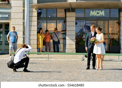 Zurich, Switzerland - September 2, 2016: Just married couple being photographed in the streets of Zurich, Switzerland