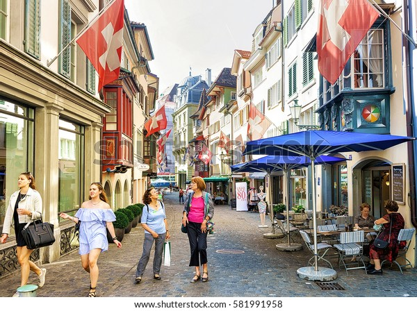 Zurich, Switzerland - September 2, 2016: People on Augustinergasse pedestrian Street in Zurich old city center, Switzerland