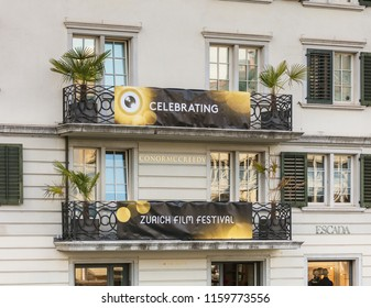Zurich, Switzerland - September 27, 2017: facade of a building in the old town of the city with balconies bearing banners of Zurich Film Festival, which takes place annually at the end of September.