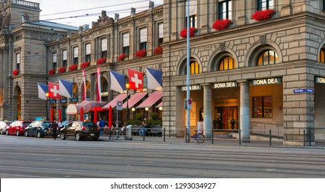 Zurich, Switzerland - September 29, 2017: facade of the Zurich main station at dusk, people and cars in front of it. Zurich main station is the largest railway station in Switzerland.