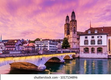Zurich, Switzerland.  View of historic city center of Zurich with famous Fraumunster Church and Munsterbucke crossing river Limmat.
