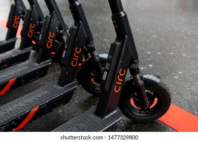 Zurich, ZH / Switzerland - August 12th 2019: Circ electric scooter parket at the trainstation on a rainy day. Closeup detail shot of Circ e-scooter branding and logo.