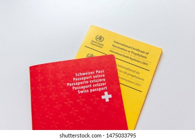 Zurich, ZH, Switzerland - August 8th 2019: Canadian passport with the yellow International Certificate of Vaccination or Prophylaxis.
