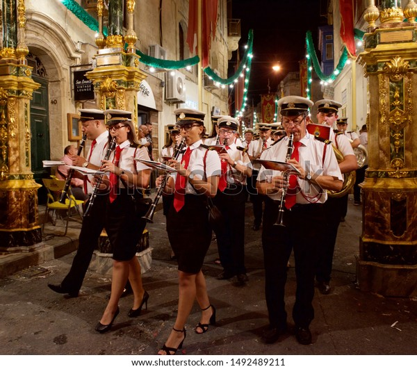 Zurrieq, MALTA - 29 aug,2019: Feast of Santa Catharina at night with celebrating maltese people. People of Malta are celebrating the Feast of Santa Catharina in Zurrieq village, Malta,editorial