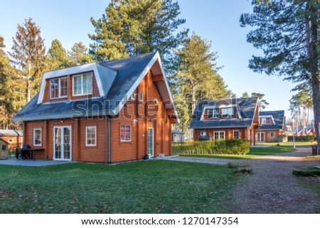 ZUTENDAAL, BELGIUM - DECEMBER 26, 2018: Beautiful wooden Accommodations located at Landal Mooi Zutendaal. captured on a nice bright sunny day