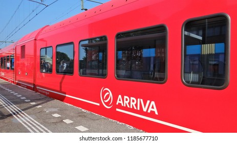 Zutphen / Netherlands - August 22 2018: A red Arriva diesel Stadler GTW train at the railway station of Zutphen with the Arriva logo at the foreground at the train