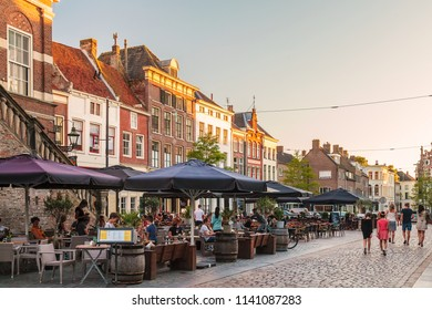 ZUTPHEN, THE NETHERLANDS - JUNE 30, 2018: Restaurants with people on the Houtmarkt central square in the Dutch city of Zutphen, The Netherlands