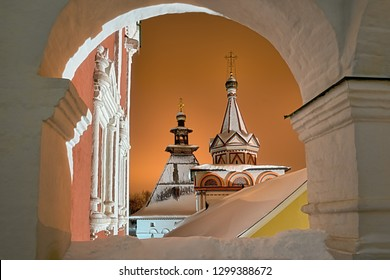ZVENIGOROD, MOSCOW REGION, RUSSIA - Beautiful covered snow tent-roofed tower of Red Gates and the Trinity Church of Savvino-Storozhevsky monastery in winter night after snowfall.