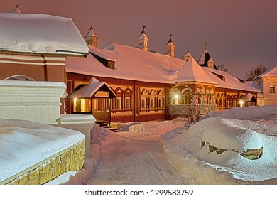 ZVENIGOROD, MOSCOW REGION, RUSSIA - Beautiful view on covered snow the old building of Tsarina's Chambers with ornate windows and porch inside the Savvino-Storozhevsky monastery in winter twilight.