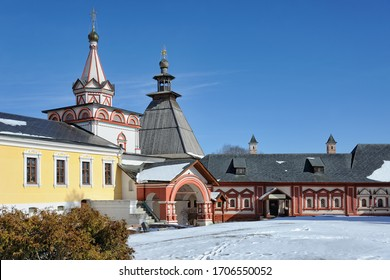 ZVENIGOROD, RUSSIA - Architectural ensemble of Savvino-Storozhevsky Monastery with a view of the beautiful colorful tent-roofed gate church of the Trinity and Tsarina Chambers after snowfall.