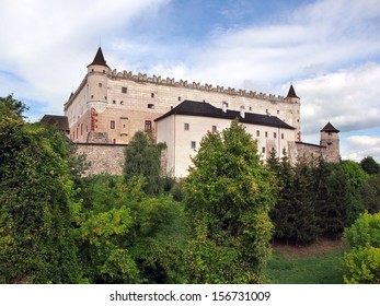 Zvolen Castle on forested hill. This castle is medieval castle build during 14th century. These days Zvolen Castle is opened for tourists and it hosts a regional branch of the Slovak National Gallery.