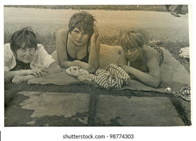 ZVOLEN, SLOVAKIA, 1964 - Three disheveled girls (aged 17 years) on a blanket near the road. Image taken in : 1964