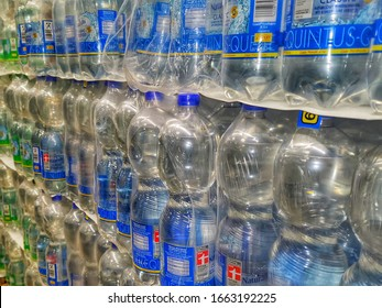 Zweibruecken/Germany- January, 12, 2020: Pallets with water bottles in a discount store. Can be bought in stock. Reusable plastic bottles.
