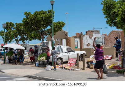Zwelihle, Hermanus, Western Cape, South Africa. Dec 2019. Traders selling fruit and vegetables on roadside  at Zwelihle township at Hermanus, Western Cape, South Africa.