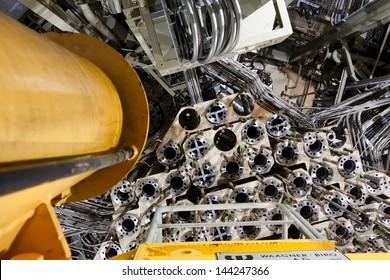 ZWENTENDORF, AUSTRIA - JUNE 1: Metal controlrod mechanism on the bottom of the reactor pressure vessel deep inside the Zwentendorf Nuclear Power Plant on June 1 2013. The plant cost 14 bill.schillings