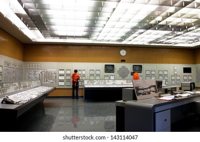 ZWENTENDORF, AUSTRIA - JUNE 1: People inside the control room of the Zwentendorf Nuclear Power Plant on June 1, 2013 in Austria. The atomic power plant was built in 1976 with a hot water reactor
