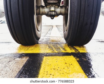 Zwo Aircraft tires at the Holding Point of a Taxi line