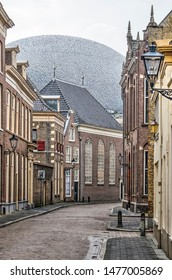 Zwolle, The Netherlands, August 2, 2019: view along a street in the old town with the blob shape of the Fundatie museum roof extansion towering over the Lutheran church