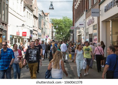 Zwolle, Overijssel / Netherlands - August 09 2014: Busy crowd shopping street at the inner city in summer