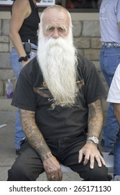 ZZ Top-looking man with tattoos posing at the 67th Annual Sturgis Motorcycle Rally, Sturgis, South Dakota, August 6-12, 2007