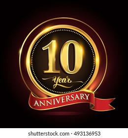 10 years celebration anniversary logo with golden ring and red ribbon.