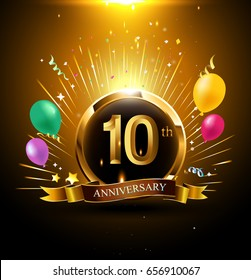 10 years golden anniversary logo celebration with ring, ribbon, firework, and balloon