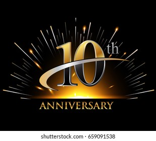 10 years golden anniversary logo celebration with firework and swoosh on dark background