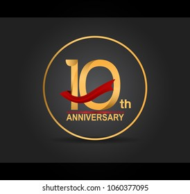 10th anniversary design golden color with ring and red ribbon isolated on black background for celebration