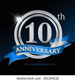 10th anniversary logo with blue ribbon and silver ring, vector template for birthday celebration.