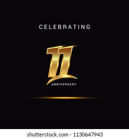 11 Years anniversary celebration golden logotype with swoosh isolated on black background, vector illustration design for greeting card, company event, invitation card, birthday
