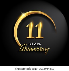 11 years anniversary celebration. Anniversary logo with ring and elegance golden color isolated on black background, vector design for celebration, invitation card, and greeting card