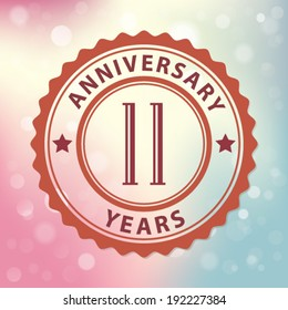 """""""11 Years Anniversary"""" - Retro style seal, with colorful bokeh background EPS 10 vector"""