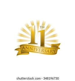 11th anniversary ribbon logo with golden rays of light