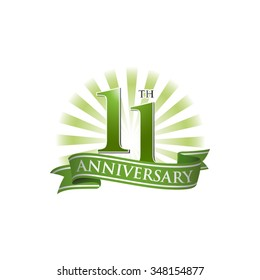 11th anniversary ribbon logo with green rays of light