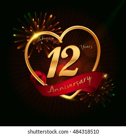 12 years anniversary logo golden colored,with love shape, red ribbon, and fireworks background