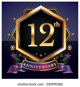 12 years golden anniversary logo celebration with ring and ribbon.
