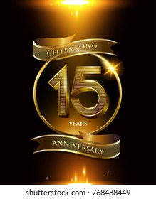 15 years anniversary logo with shiny ribbon and golden ring isolated on black background