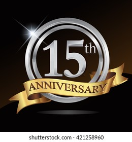15th anniversary logo, with shiny silver ring and gold ribbon isolated on black background. vector design for birthday celebration.