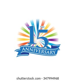 15th anniversary ribbon logo with colorful rays of light