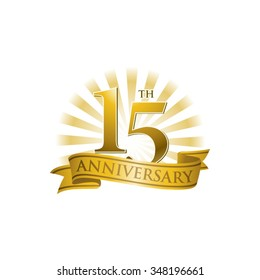 15th anniversary ribbon logo with golden rays of light