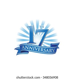 17th anniversary ribbon logo with blue rays of light