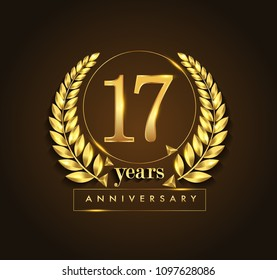 17th gold anniversary celebration logo with golden color and laurel wreath vector design.