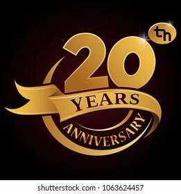 20 years golden anniversary logo celebration with golden ring and ribbon.